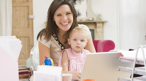 mum at laptop with child